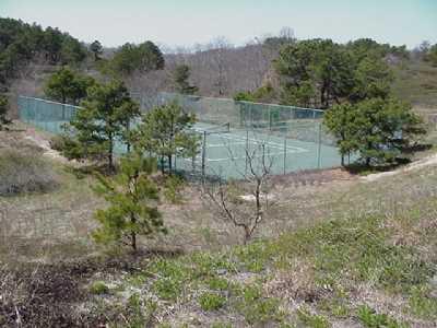 Shared Tennis Court in Association